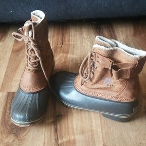 Sorel leather rain snow all weather boots.